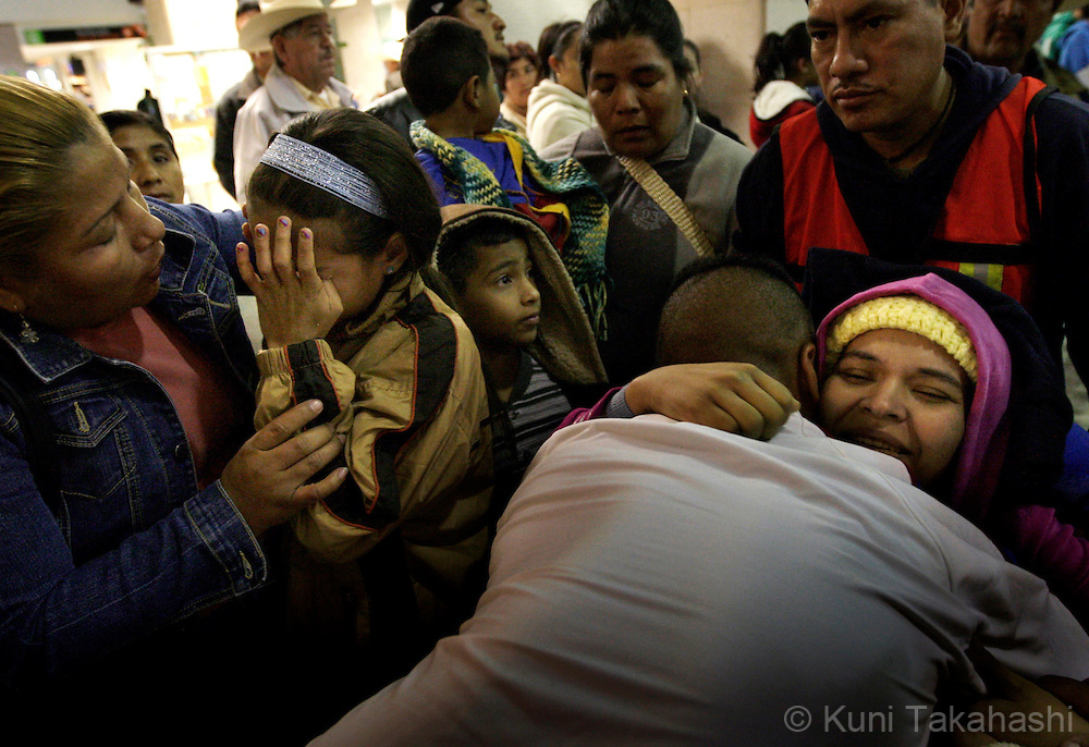Mariana de la Torre, 29, gets embraced by her brother Jose Manuel as she arrives at Morelia airport in Mexico on Feb 23, 2009 while her daughter Andrea, 11, is comforted by Mariana's aunt Maribel. (Photo by Kuni Takahashi)