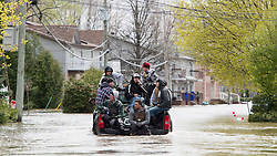 Volunteers ride in the back of a pick-up truck as they make their way into the flood zone Monday, May 8, 2017 in Gatineau, Quebec, Canada. Photo by Adrian Wyld /The Canadian Press/ABACAPRESS.COM