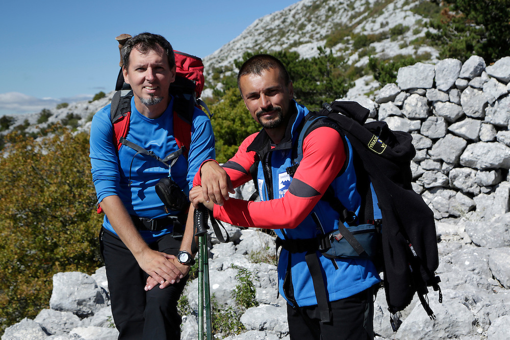 Denis Vranjes, mountain guide, and Kenan Muftic, Walking the Via Dinarica project leader, on the ridge of Mosor mountain, Croatia - 01 October 2013