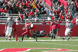 02 October 2010: All alone, Marvon Sanders trots into the end zone for a touchdown during an NCAA football game where the Southern Illinois Salukis beat the Illinois State Redbirds 3817 at Hancock Stadium in Normal Illinois.