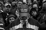 Donald Trump supporters listen to the speech during the inauguration of President Donald Trump, Friday, Jan. 20, 2017, in Washington. Protesters registered their rage against the new president Friday in a chaotic confrontation with police who used pepper spray and stun grenades in a melee just blocks from Donald Trump's inaugural parade route. Scores were arrested for trashing property and attacking officers.