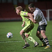 Louis Almond (Southport) shields the ball to try and offload to one of the other Southport attackers during the Vanarama National League match between Gateshead and Southport at Gateshead International Stadium, Gateshead, United Kingdom on 8 December 2015. Photo by Mark P Doherty.