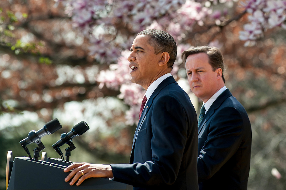 President BARACK OBAMA and British Prime Minister DAVID CAMERON hold a joint press conference in the Rose Garden at  the White House on Wednesday.