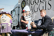 Royal Highland Show, 2014. Halls reclaim World's largest haggis record at the `Highland Show. 15 year old Cameron Hill from Kilmarnock, son of Browns Food Group director addresses the haggis. PAYMENT TO CRAIG STEPHEN 07905 483532