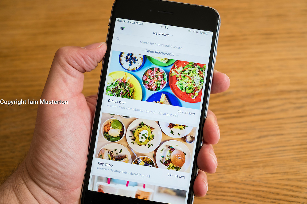 UberEats app for restaurant delivery services in New York shown on an iPhone 6 smartphone