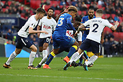 AFC Wimbledon striker Lyle Taylor (33) surrounded by tottenham payers during the The FA Cup 3rd round match between Tottenham Hotspur and AFC Wimbledon at Wembley Stadium, London, England on 7 January 2018. Photo by Matthew Redman.