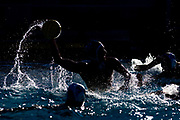 Vikings' Nick Alden (22) shoots on goal during Saturday's Coast Conference Championship semifinal water polo game against Merced College.