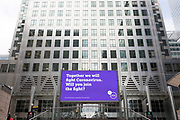 As the UK's Conornavirus pandemic lockdown continues, but with travel restrictions and social distancing rules starting to ease after three months of closures and isolation, a digital billboard from Guys and St. Thomas' NHS hospitals advertises the fight against the Covid threat, at Canary Wharf, on 9th June 2020, in London, England.