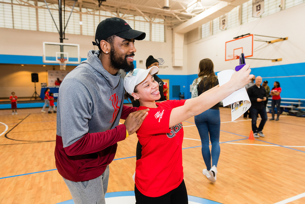NBA star Kyrie Irving poses with BGCC 2015 Youth of the Year Zayllianny Mojica during the Kids Foot Locker Fitness Challenge kickoff event at Boys & Girls Clubs of Cleveland on Friday, Jan. 20, 2017, in Cleveland. (Jason Miller/AP Images for Kids Foot Locker)