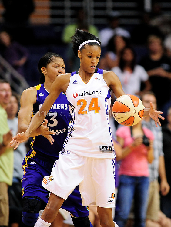 Sep 3, 2011; Phoenix, AZ, USA; Phoenix Mercury guard .DeWanna Bonner (24) is guarded by Los Angeles Sparks forward Candace Parker (3) during the second half at the US Airways Center.  The Mercury defeated the Sparks 93-77. Mandatory Credit: Jennifer Stewart-US PRESSWIRE