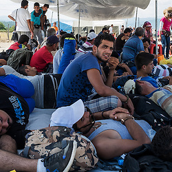 Refugees wait at a reception center near the Macedonian town of Gevgelija, near the border with Greece on August 25, 2015.