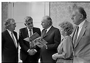 "Draught Horse Publication Presented To President Hillery. (T3)..1989..05.07.1989..07.05.1989..5th July 1989..President Hillery was presented with the first copy of the new publication, ""The Irish Draught Horse"", by the Irish Draught Horse Society..Among those at the presentation were the books author Mr Michael Slavin (L) and mr Fintan Flannelly, National Chairman, Irish Draught Horse Society..The event was photographed at Aras an Uachtarain, Phoenix Park, Dublin."