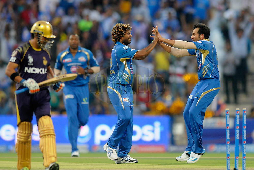 Lasith Malinga of the Mumbai Indians celebrates the wicket of Gautam Gambhir captain of the Kolkata Knight Riders during match 1 of the Pepsi Indian Premier League Season 7 between the Mumbai Indians and The Kolkata Knight Riders held at the Sheikh Zayed Stadium, Abu Dhabi, United Arab Emirates on the 16th April 2014<br /> <br /> Photo by Pal Pillai / IPL / SPORTZPICS