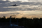 An American Airlines Boeing 777 arrives across a car park at sunrise for landing at Heathrow airports north runway.  Heathrow Airport, London. (photo by Andrew Aitchison / In pictures via Getty Images)