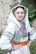 Brodsko kolo, Slavonski Brod, Croatia. Young woman from Rečica, near Karlovac, in traditional folk costume. The Brodsko kolo, now in its 49th year, is the oldest folk dancing festival in Croatia.