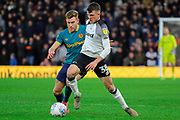 Derby County midfielder Jason Knight and Hull City defender Callum Elder challenge during the EFL Sky Bet Championship match between Derby County and Hull City at the Pride Park, Derby, England on 18 January 2020.