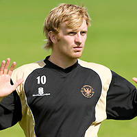 St Johnstone Training....07.08.09<br /> Liam Craig stretches during training this morning ahead of tomorrow's friendly against Burnley<br /> Perthshire Picture Agency<br /> Tel: 01738 623350  Mobile: 07990 594431