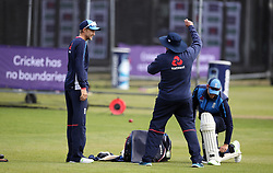 England's captain Joe Root, (left) chats with coach Trevor Bayliss during the nets session at Lord's, London.