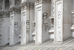© Licensed to London News Pictures. 07/06/2020. London, UK. The letters BLM (Black Lives Matter) is seen sprayed on the walls of the Foreign Office after yesterday's protest march. New quarantine rules on passengers entering the United Kingsom come into force tomorrow. People entering the country will have to quarantine for two weeks. Photo credit: Peter Macdiarmid/LNP