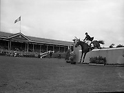 RDS Horse Show.  Seamus Hayes on Goodbye clearing a jump in the Nation Cup, Aga Khan Trophy.<br /> 08.08.1963