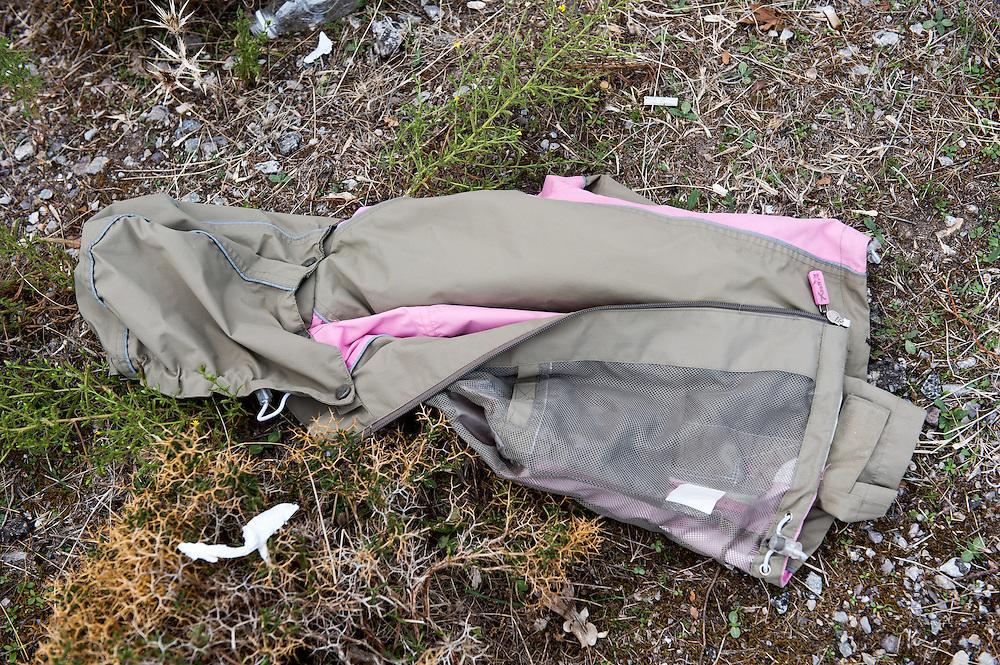 Discarded children's clothes near Skala Sykamias, Lesvos, Greece.