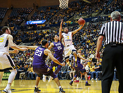 Feb 12, 2018; Morgantown, WV, USA; West Virginia Mountaineers guard James Bolden (3) shoots a layup while defended by TCU Horned Frogs guard Alex Robinson (25) during the second half at WVU Coliseum. Mandatory Credit: Ben Queen-USA TODAY Sports