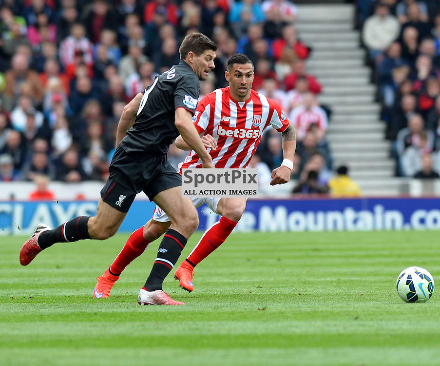 Liverpool captain Steven Gerrard fights for the ball with Stoke player Marko Arnautovic