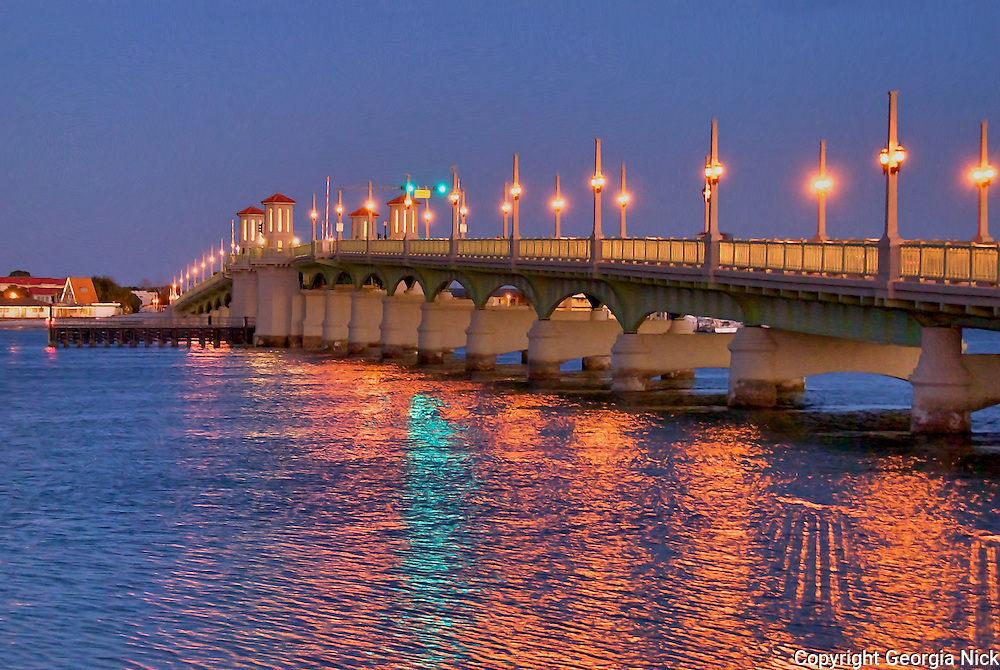 The new Bridge of Lions, St. Augustine, Florida lights up the Matanzas River on a mid January evening.