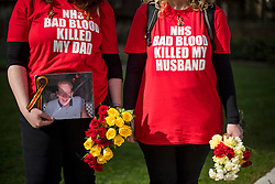 © Licensed to London News Pictures. 12/04/2016. London, UK. SARAH DORRICOTT and ANN DORRICOTT hold a picture of their father and husband Mike Dorricott who died after being given blood infected with Hepatitis C. Campaigners and victims of contaminated blood gather outside the Houses of Parliament in London on the day that the House of Commons will debate government plans to reform payouts to people infected by contaminated blood. The blood scandal saw some 6,000 people, many with the blood disorder haemophilia, infected with HIV and hepatitis C by infected blood products used by the NHS up until 1991.Photo credit: Ben Cawthra/LNP