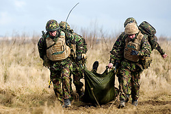 4 Mech Bde taking part in realistic Mission Specific Training on Salisbury Plain Training Area before deployment to Helmand Province Afghanistan. after initial first aid members of the Royal Dragoon Guards move the simulated battle casualty to a stretcher team and medic where more extensive first aid can be provided.  9 Feb 2010