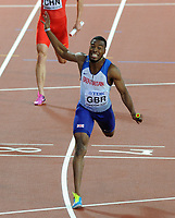 Athletics - 2017 IAAF London World Athletics Championship - Day Thirteen, Evening Session<br /> <br /> Men's 5000m Final<br /> <br /> Nethaneel Mitchell - Blake of Great Britain crosses the line to win the Gold medal ahead of the Americans at the London Stadium.<br /> <br /> COLORSPORT/ANDREW COWIE