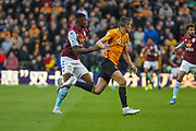 Conor Coady of Wolverhampton Wanderers & Wesley of Aston Villa during the Premier League match between Wolverhampton Wanderers and Aston Villa at Molineux, Wolverhampton, England on 10 November 2019.