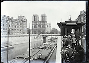 Paris around 1900 exit Chemin de Fer d'Orleans along the Seine with Cathedrale Notre Dame
