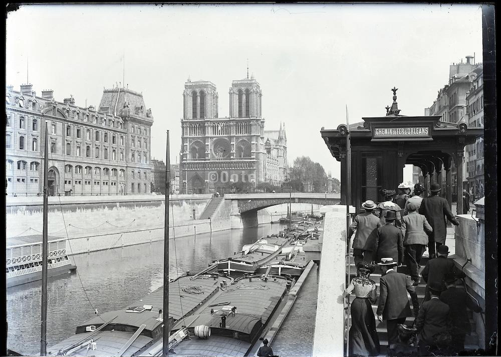 Paris around 1900 exit Chemin de Fer d'Orleans along the Seine with Cathedrale Notre Dame