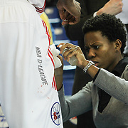 Delaware 87ers Athletic Trainer Christina Kennedy removes blood from 87ers Forward Thanasis Antetokounmpo (19) shorts in the first half of a NBA D-league regular season basketball game between the Delaware 87ers (76ers) and the Iowa Energy Tuesday, Jan 14, 2014 at The Bob Carpenter Sports Convocation Center, Newark, DE