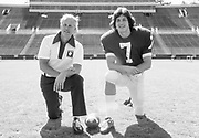 PALO ALTO, CA -  MARCH 1977:  Head coach Bill Walsh and quarterback Guy Benjamin of Stanford University pose on the field during March 1977 at Stanford Stadium in Palo Alto, California.  (Photo by David Madison/Getty Images)