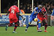 AFC Wimbledon striker Tom Elliott (9) holding off Walsall forward Amadou Bakayoko (20) during the EFL Sky Bet League 1 match between AFC Wimbledon and Walsall at the Cherry Red Records Stadium, Kingston, England on 25 February 2017. Photo by Matthew Redman.