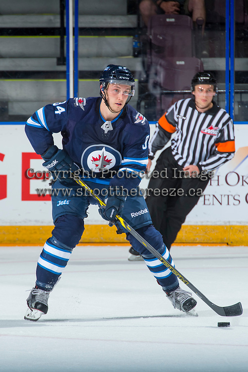 PENTICTON, CANADA - SEPTEMBER 9: Michael Webster #94 of Winnipeg Jets skates with the puck against the Edmonton Oilers on September 9, 2017 at the South Okanagan Event Centre in Penticton, British Columbia, Canada.  (Photo by Marissa Baecker/Shoot the Breeze)  *** Local Caption ***
