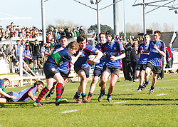 """"""" Rice on the Boil """" .Rice College's Dwayne Corcoran breaks through the Calasanctius tackles with  support from Michael O Grady and Tim O' Malley ...Pic Conor McKeown"""