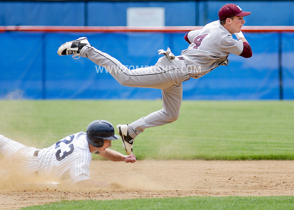 Kingston shortstop Zach Short, right, leaps over Pine Bush baserunner Andrew Overton (23) at second base during the Section 9 Class AA baseball championship game at SUNY New Paltz on Friday June 1, 2012.