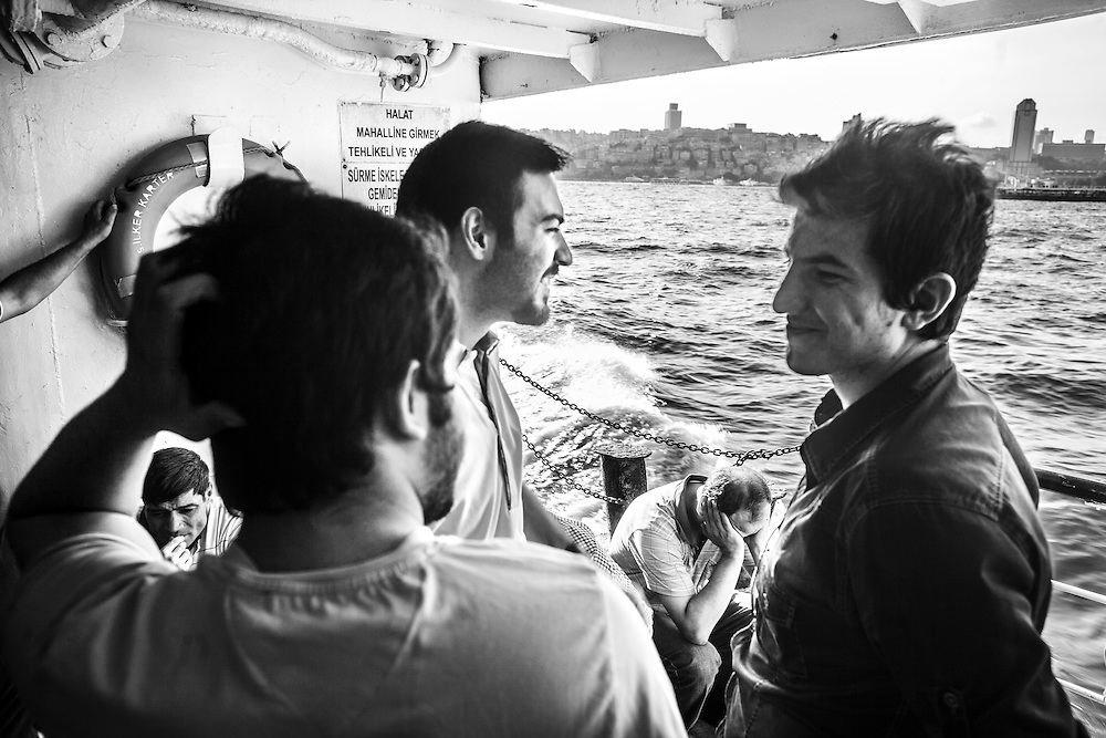 Young men chat on a Istanbul ferry boat.