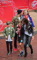 Mini London marathon 2015, The Borough Challenge Boys Under 13 race. David and Victoria Beckham with the rest of their family congratulate Romeo Beckham (12) after crossing the finish line on The Mall. The Virgin Money Giving Mini Marathon, Sunday 26th April 2015.<br />