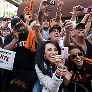 San Francisco Giants fans scream and take photos of pitcher Tim Lincecum during the World Series parade in San Francisco, California.