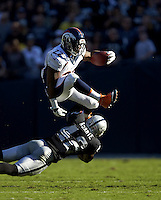 Football: Denver Broncos C.J. Anderson (22) in action, rushing vs Oakland Raiders Larry Asante (42) at O.co Coliseum.<br /> Oakland, CA 11/9/2014<br /> CREDIT: Jed Jacobsohn (Photo by Jed Jacobsohn /Sports Illustrated/Getty Images)<br /> (Set Number: X158921 TK1 )