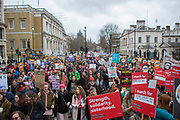 UNITED KINGDOM, London: 04 March 2018 Hundreds of picket signs and posters can be seen in the crowd during the #March4Women rally through London this afternoon on Whitehall. Thousands of people marched from Parliament to Trafalgar Square to celebrate International Women's Day and 100 years since the first women in the UK gained the right to vote. <br /> Rick Findler / Story Picture Agency