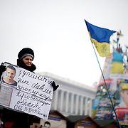 December 19, 2013 - Kiev, Ukraine: A Pro-EU demonstrator holds a poster at Independence Square.<br /> On the night of 21 November 2013, a wave of demonstrations and civil unrest began in Ukraine, when spontaneous protests erupted in the capital of Kiev as a response to the government&rsquo;s suspension of the preparations for signing an association and free trade agreement with the European Union. Anti-government protesters occupied Independence Square, also known as Maidan, demanding the resignation of President Viktor Yanukovych and accusing him of refusing the planned trade and political pact with the EU in favor of closer ties with Russia.<br /> After a days of demonstrations, an increasing number of people joined the protests. As a responses to a police crackdown on November 30, half a million people took the square. The protests are ongoing despite a heavy police presence in the city, regular sub-zero temperatures, and snow. (Paulo Nunes dos Santos/Polaris)