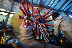 October 6, 2018 - Lalitpur, Nepal - An artist giving touches on an idol of Goddess Durga for the upcoming Dashain festival in Lalitpur, Nepal on Saturday, October 06, 2018. (Credit Image: © Skanda Gautam/ZUMA Wire)