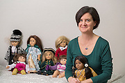 Ann Carrns, of Fayetteville, Ark., sits in her daughter's room among a collection of American Girl doll's on Friday, March 13, 2015, in Fayetteville, Ark. Photo by Beth Hall