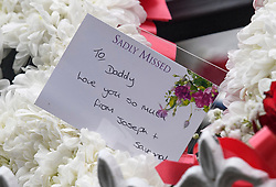"© Licensed to London News Pictures. 14/02/2020. Sevenoaks, UK. A note left on flowers from the children of Joey Smith, as the coffins leave St John the Baptist church in Sevenoaks, Kent following the funeral service of traveller brothers Billy and Joe Smith. The twin brothers, who were made famous by the television programme ""My Big Fat Gypsy Wedding"", were found hanged in woodland three days after Christmas. Photo credit: Ben Cawthra/LNP"