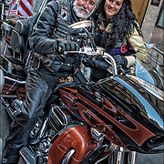 Vietnam Veteran and daugher, both bikers, he is wearing his military decorations at Veteran Day Parade.  <br /> <br /> The sole purpose of the  parade is to honor the service of our veterans and to salute our currently serving military.<br /> <br /> Medals are given to an individual as a distinctively designed mark of honor denoting heroism, or meritorious or outstanding service or achievement.